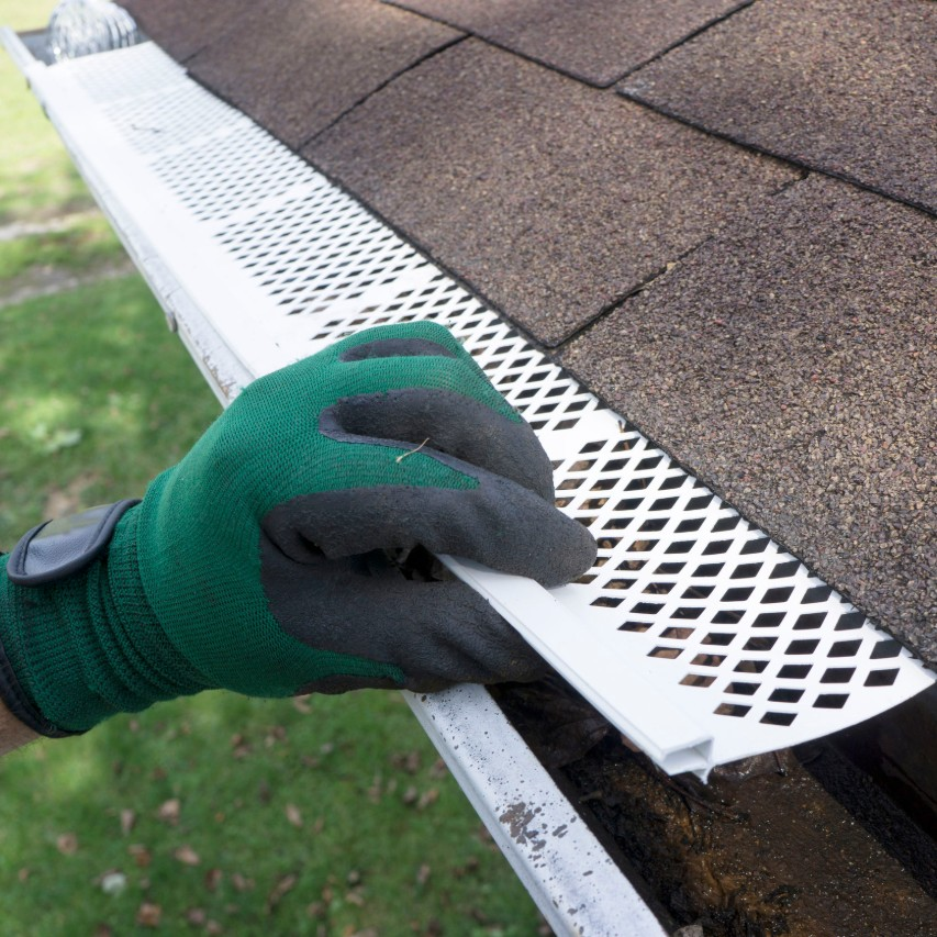gutter guard along the roof edge