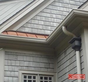 Gutters Along A House With Cedar Siding