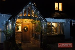 Christmas Lights on Front of House at Night