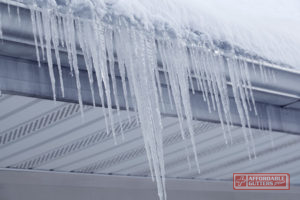 Icicles Formed Over the Gutters of a Home.